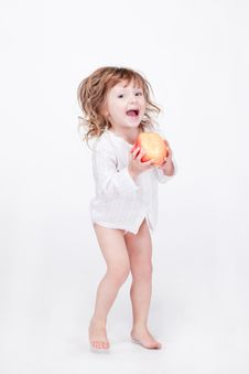 Free Cute Child Jumping With Apple Royalty Free Stock Image - 15212846