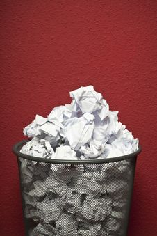 Trashcan Filled With Rumpled Paper Stock Photography