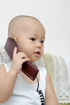 Free Baby With Telephone Royalty Free Stock Image - 15218696