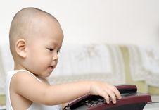 Free Baby With Telephone Stock Photos - 15218703