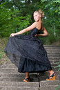 Free Posh Young Lady Posing In The Park Royalty Free Stock Images - 15220059