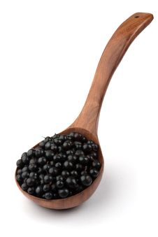Currant In A Wooden Spoon Royalty Free Stock Images