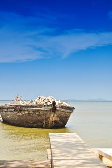 Free Wooden Boat And Blue Sky Royalty Free Stock Image - 15225596