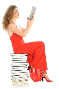 Free Woman Sits On Books And Reads Royalty Free Stock Photo - 15226275