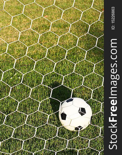 Football inside goal