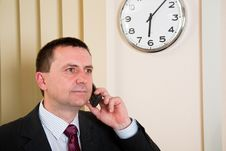 Free Businessman Talking On The Phone Royalty Free Stock Image - 15231086