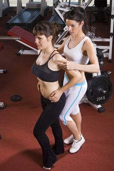 The Coach Helps Girl Posing In The Gym Stock Photos