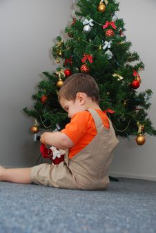 Baby Sitting Under The Christmas Tree Royalty Free Stock Images