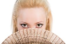 Young Beautiful Blond Girl With A Fan Royalty Free Stock Photography
