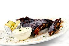 Free Pork Ribs With A Baked Potato And Sour Cream Royalty Free Stock Image - 15237586