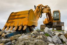 Free Excavator On Heap Of Stones Royalty Free Stock Photo - 15238605
