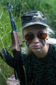 Blonde In Spectacles With Weapon Royalty Free Stock Photos