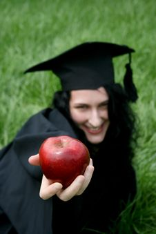 Young Smiling Caucasian Student With Apple Stock Photos