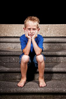 Free Young Boy Sitting Royalty Free Stock Images - 15246309