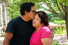 Free Hispanic Man Kissing His Mother Outdoors Royalty Free Stock Photo - 15246835