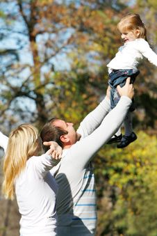Happy Family In Park Stock Images