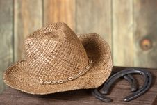 Free Western Scene With Cowboy Hat And Horseshoes Royalty Free Stock Photography - 15252307