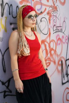 Rapper Girl Posing At Sprayed Wall Royalty Free Stock Photo