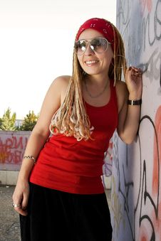 Hip-hop Styled Girl In Red Laughing Outdoors Stock Photos