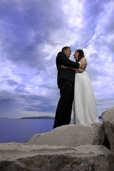 Wedding Couple By The Sea Royalty Free Stock Photography