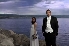 Wedding Couple By The Sea Stock Photos
