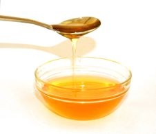 Honey From A Spoon Stock Photos