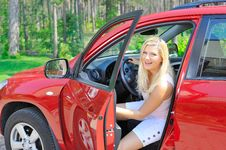 Free Beautiful Woman Driver In Red Shiny Car Royalty Free Stock Photos - 15253818