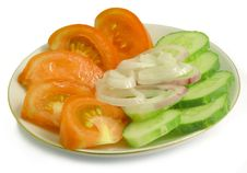 Tomatoes, Cucumbers, Onions On A Saucer Stock Photo