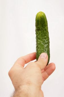 Free Cucumber In Hand Royalty Free Stock Photos - 15254728