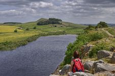 Female Hiker On Hadrian S Wall Royalty Free Stock Photo