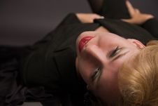 Free Blonde Woman Lying On The Floor Royalty Free Stock Photography - 15256517