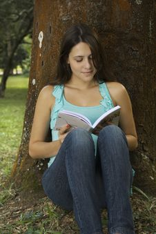 Free Woman Reading Book In Park Stock Photo - 15258370