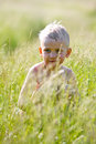 Free Wet Boy On The Field Among The Grass Royalty Free Stock Image - 15260036