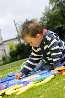 Free White Boy Studying Alphabet In Park Stock Photo - 15261060