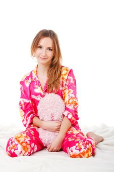 Free Sweet Young Girl In Pink Pajamas On Bed Royalty Free Stock Photos - 15262188