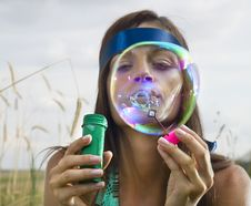 Free Face Of Woman That Blows Soap Bubbles Royalty Free Stock Photo - 15263425