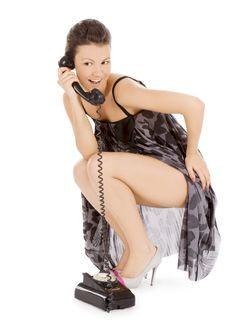 Alluring Girl In Dress Calling At The Phone Stock Image