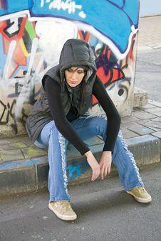 Girl Sitting On Sidewalk Royalty Free Stock Photo