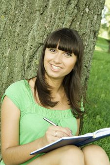 Free Female In A Park With A Notebook Royalty Free Stock Image - 15265916