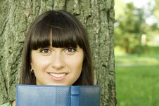 Free Female In A Park With A Notebook Royalty Free Stock Photography - 15265967