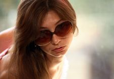 Portrait Of Young Woman With Sunglasses Stock Photo