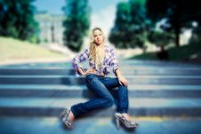 Free Blonde Young Woman Sitting On Stairs In The Park Stock Images - 15269634