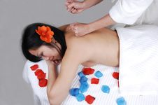 Chinese Girl Getting Massage. Royalty Free Stock Photo