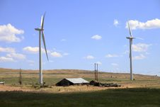 Free Wind Turbines In A Farmfield. Royalty Free Stock Images - 15271809