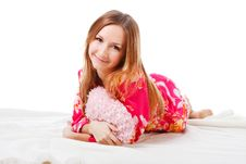 Free Sweet Young Girl In Pink Pajamas On Bed Stock Images - 15275924