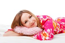 Free Sweet Young Girl In Pink Pajamas On Bed Royalty Free Stock Photography - 15275937