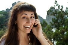 Close-up Of Happy Girl Talking The Telephone Stock Image