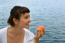 Young Girl With The Peach Stock Images