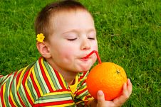 Free The Child Is Drinking Orange Juice Stock Images - 15277734