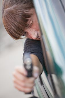 Free Woman Shooting From A Car Stock Photography - 15278172